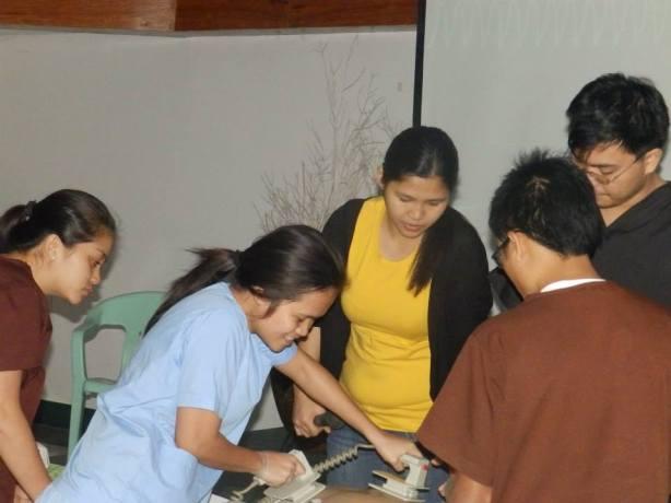 Miss Mel assisting INET Student on defibrillation.